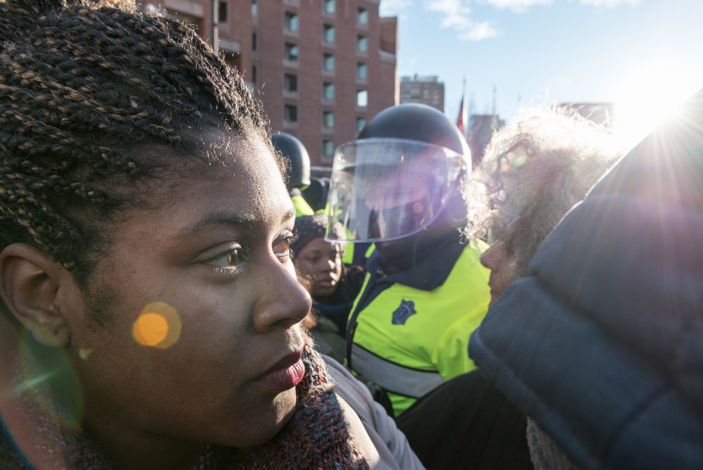 This woman was almost dragged by her neck by an officer trying to isolate and arrest her