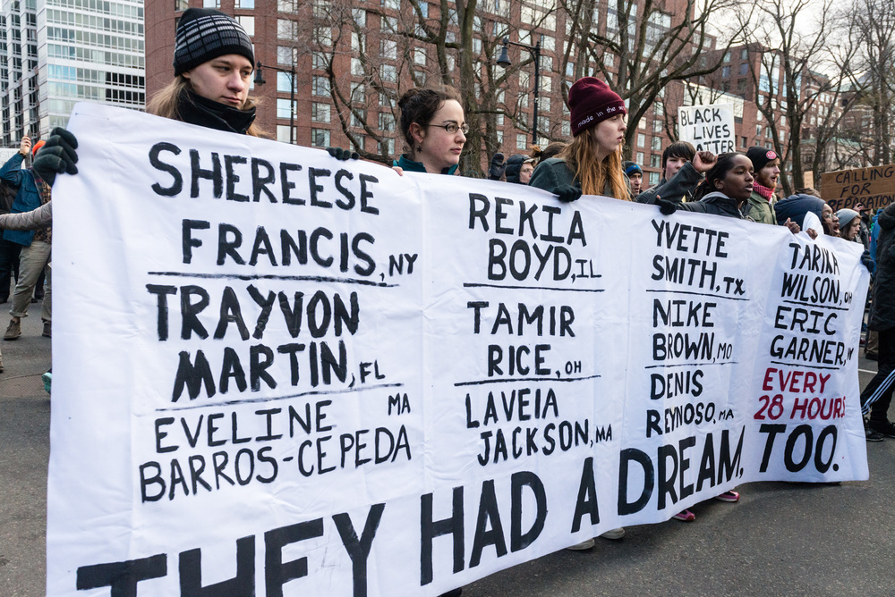 Protest banner listing the names of slain black people by police and vigilantes
