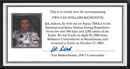 The official signed flight certification note from Yuri Malenchenko.