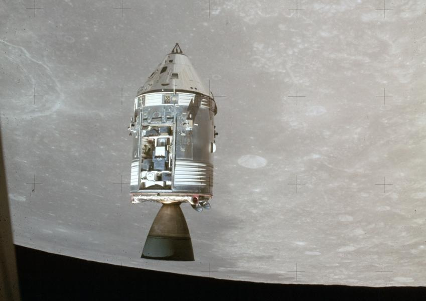 The Apollo 15 command module Endeavor in lunar orbit with its SIM bay door open. Aboard is Al Worden and the 50 $2 bills. This photo was taken from the Lunar Module, which had Dave Scott and Jim Irwin aboard.