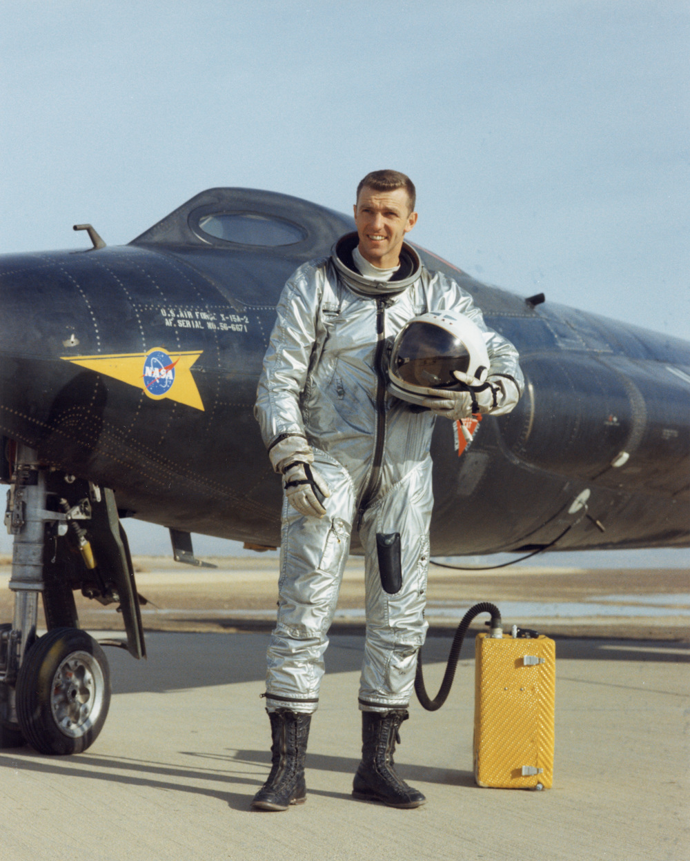 Test pilot Joe Engle in his David Clark Company pressure suit standing in front of the X-15 rocket plane.