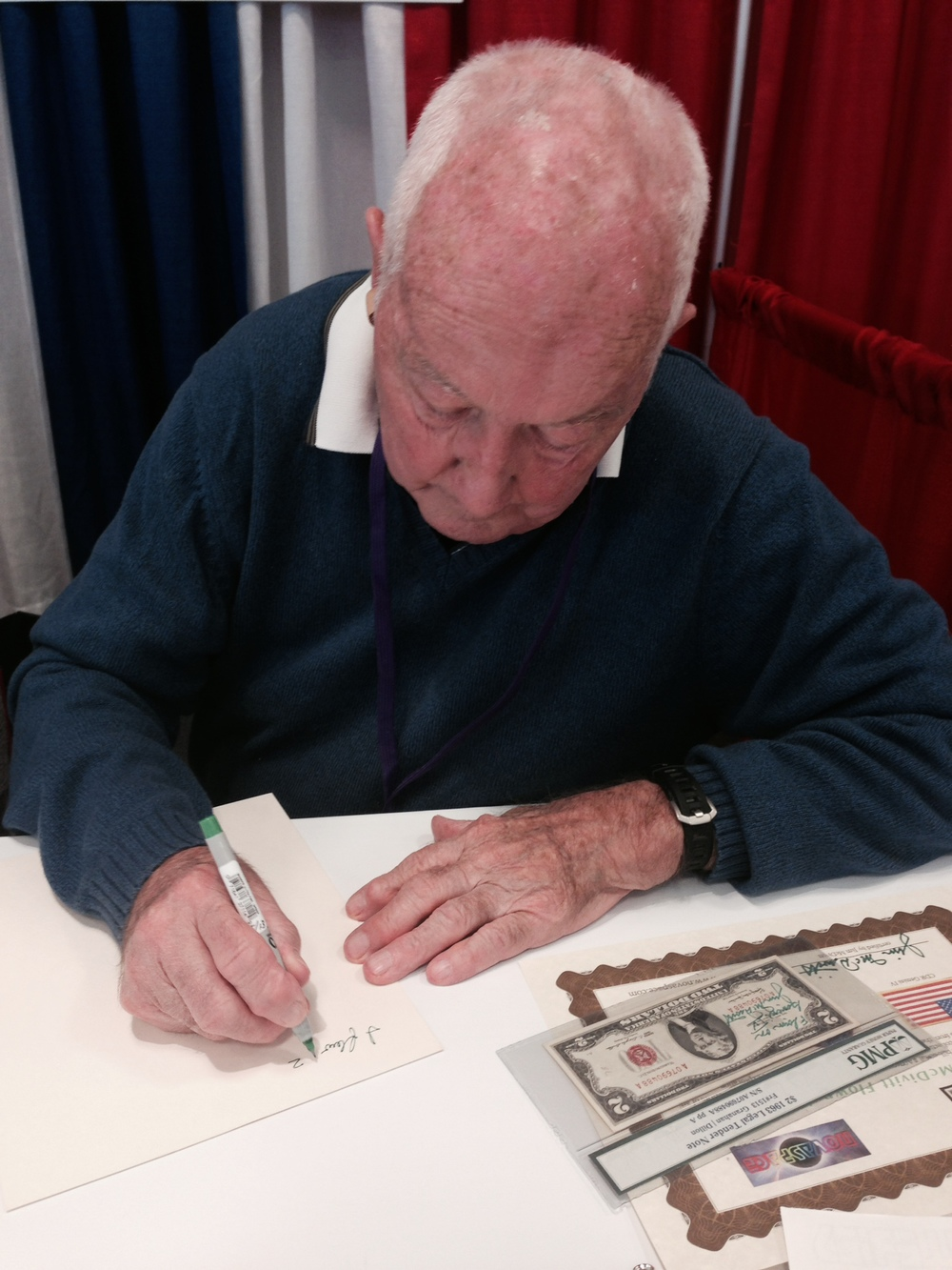 Jim McDivitt hand certifying his reason for carrying the $2 bill on his Gemini mission for the historic record.