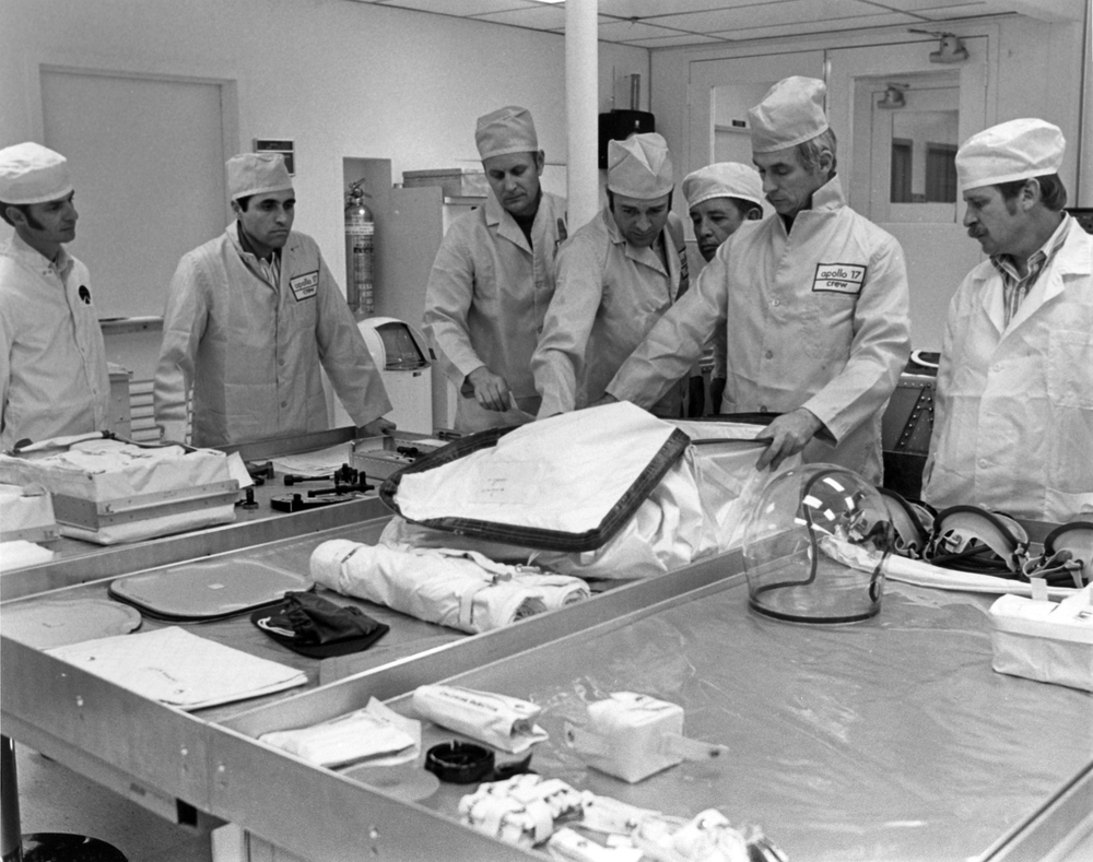 A rare photo of Bob Horne and his team discuss the stowage of crew equipment and personal items with the Apollo 17 crew. Bob is standing between A17 CMP Ron Evans, and CDR Gene Cernan.