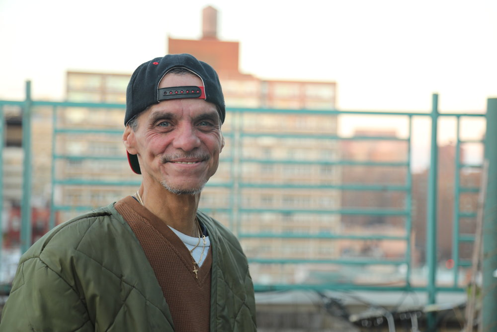 Man on rooftop - E 12th Street SRO.JPG