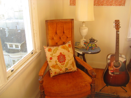 Orange chair and guitar