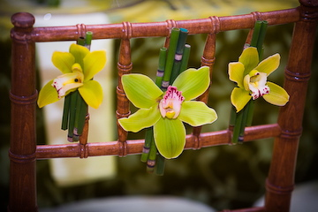 Orchid and bamboo chair decor
