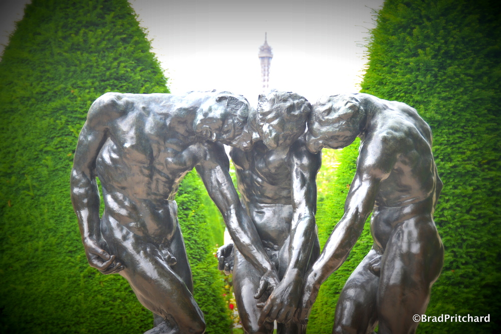 "Rodin's ""The Three Shades"" at Musée Rodin with the Eiffel Tower in the background"