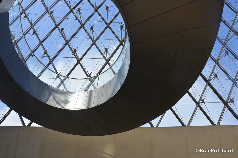 I. M. Pei's Louvre Pyramid and Spiral Staircase