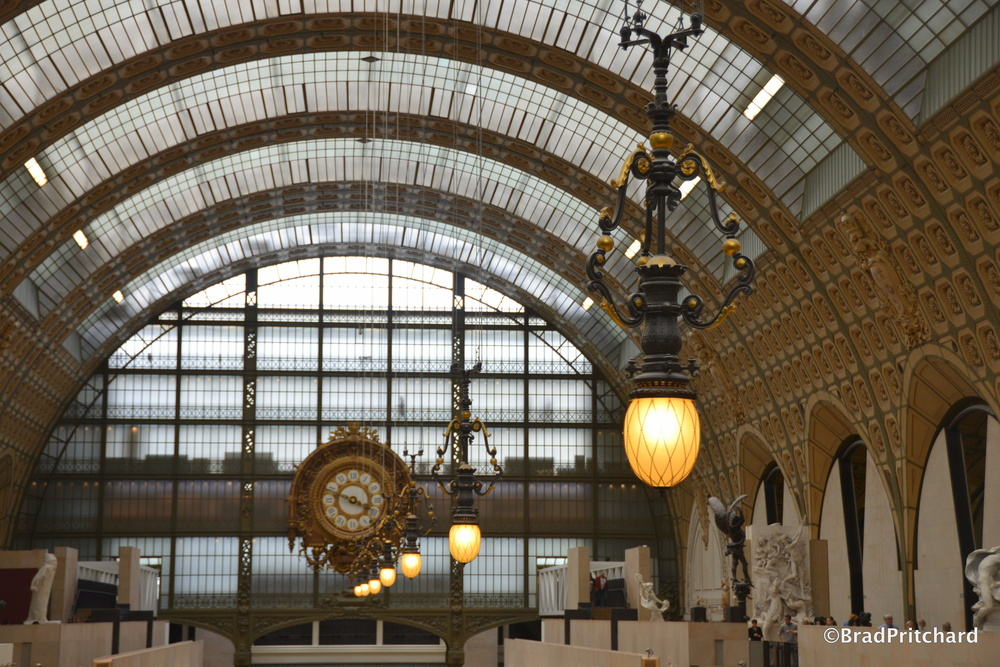 The beautiful celing, clock and light fixtures which were once part of the Gare d'Orsay train station... the space transformed into one of the greatest museums on the planet... Musée d'Orsay