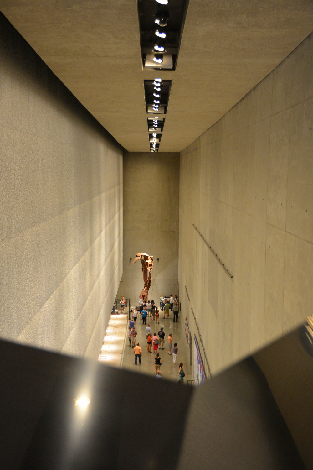 Looking down to the bottom floor of the museum. The wall to the left represents where the South Tower once stood. The mangled structure at the end of the hallway is the steel facade just below the point where Flight 11 struck the North Tower.