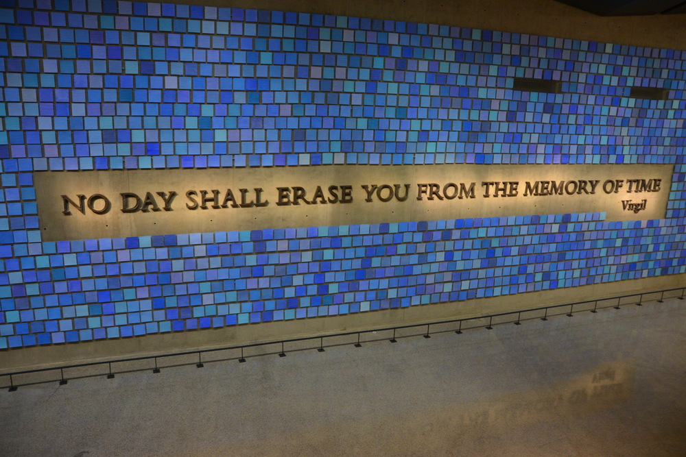 "A quotation from Virgil's ""Aeneld"". The letters were constructed from medal salvaged from the Ground Zero site. The blue tiles represent the artist's attempt to recapture the blue color of the NYC sky the morning of 9/11."
