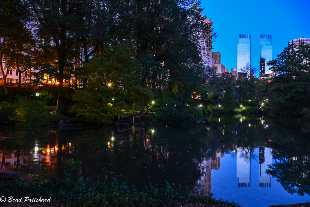 At the southern end of the park, Columbus Circle reflecting the early morning light from the horizon.