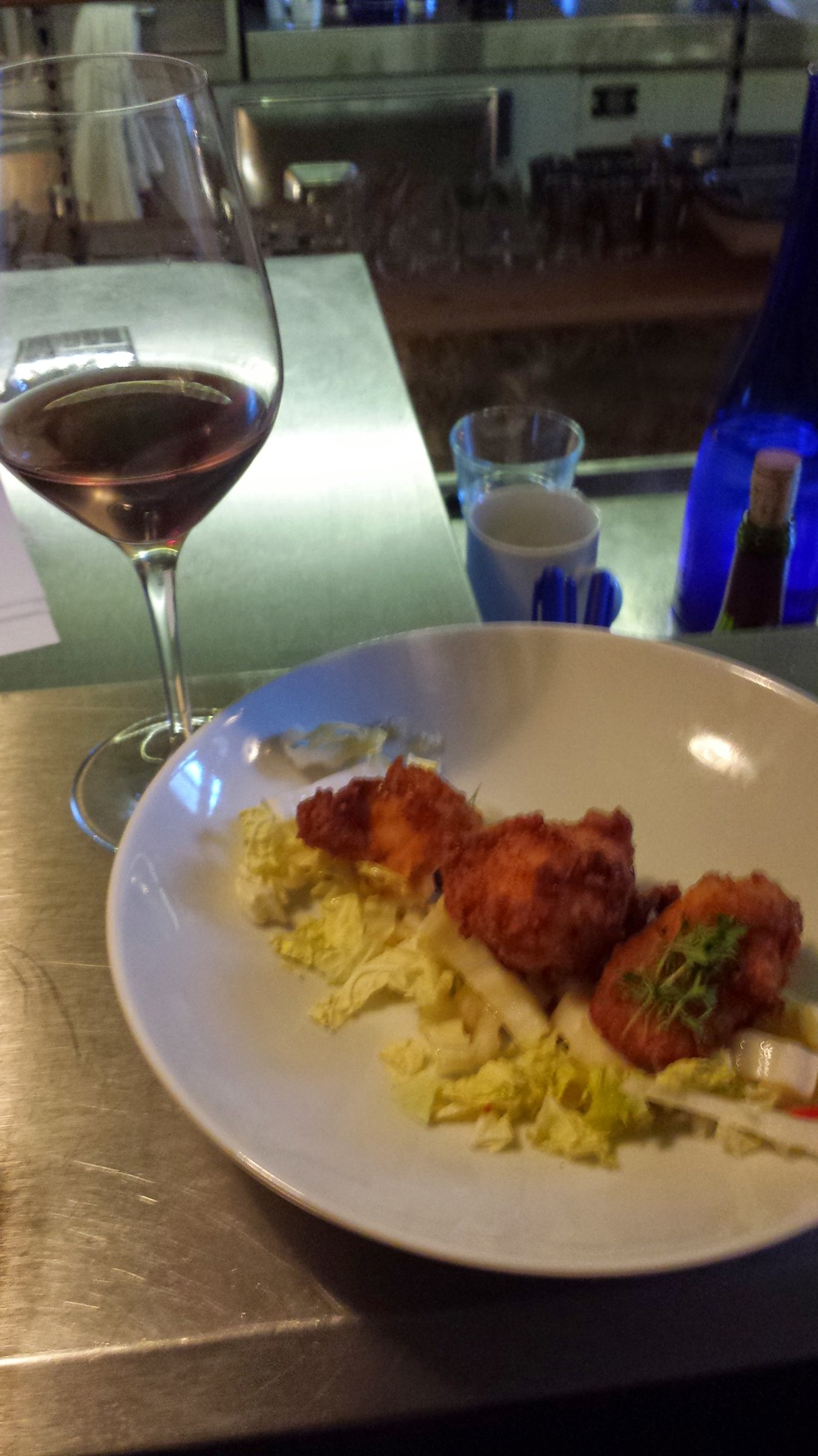 Buttermilk fried chicken with napa cabbage, red chilies, and micro greens.
