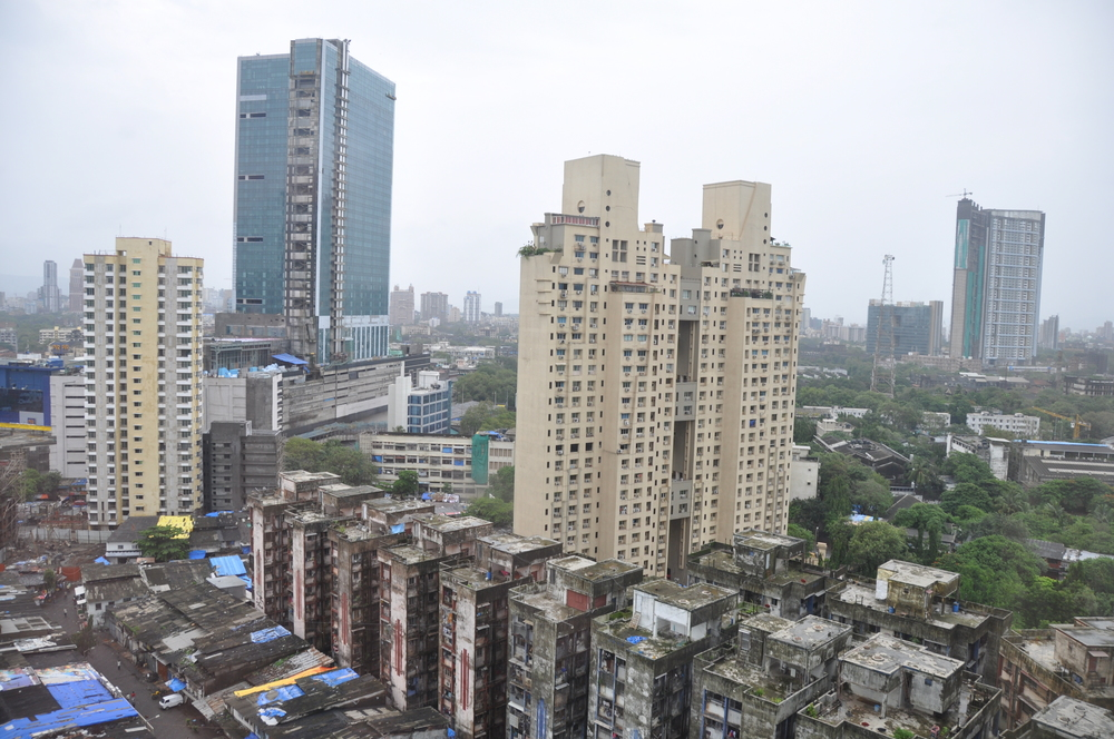 Many layers of architecture from the poor (one and two level shacks) to the rich (high rise)