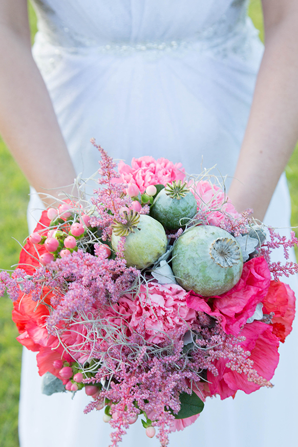 Bridal Bouquet from Fiddlesticks Floral Design. Wedding dress by Sherry Bridal Couture.