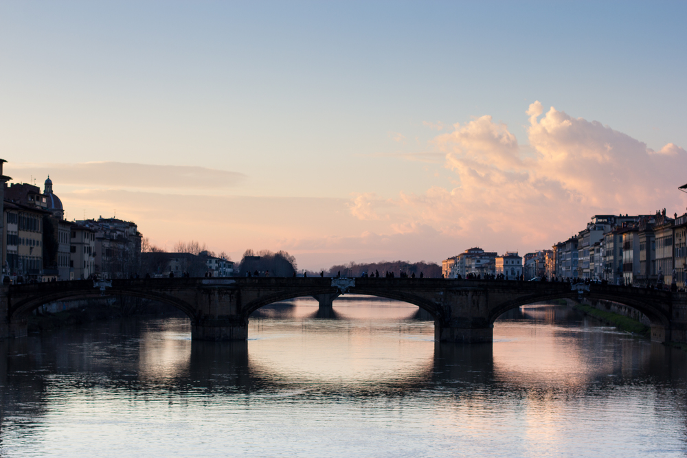 Strolling along the Arno River, especially at sunset