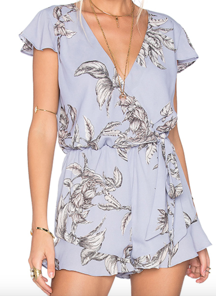 I'm actually obsessed with this ruffled purple romper by Tularosa!