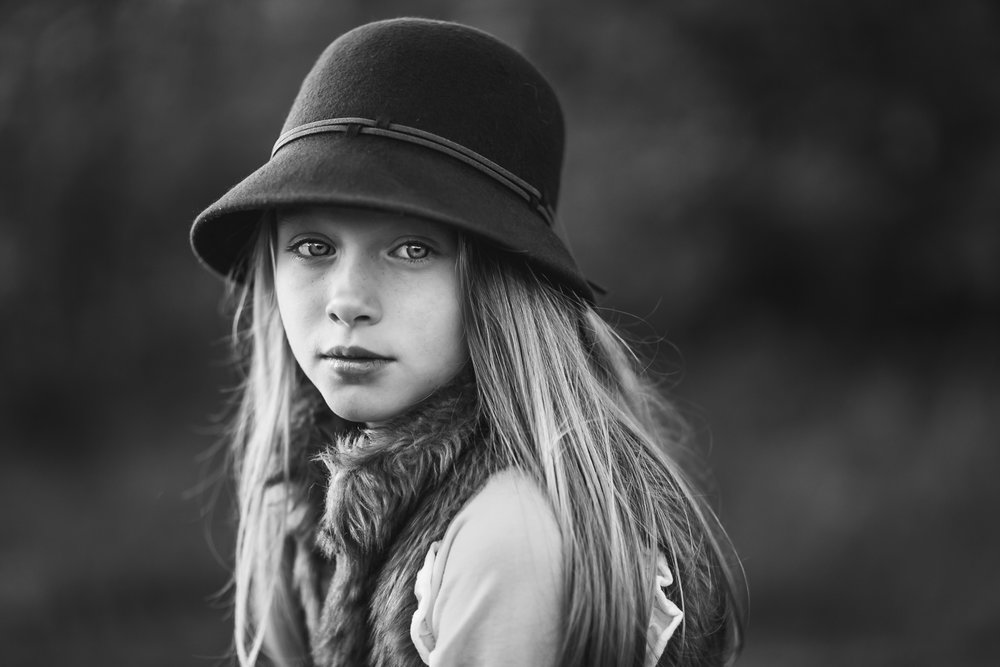 A-picture-of-a-young-girl-in-a-hat-by-Sandra-Jolly.jpg