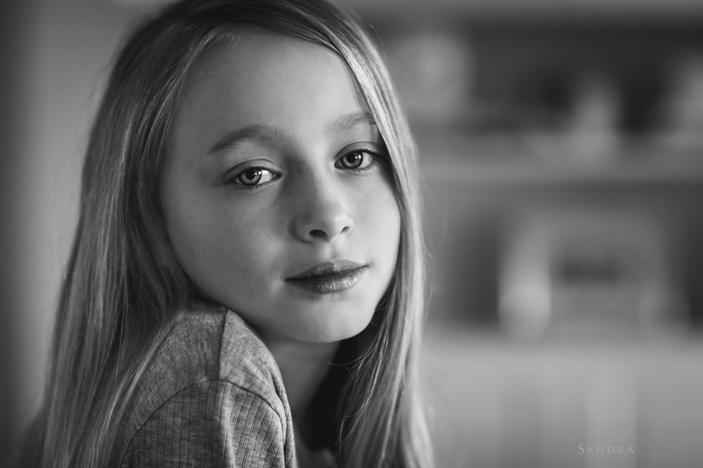 Black-and-white-portrait-of-a-young-girl-by-barnfotograf-Sandra-Jolly.jpg