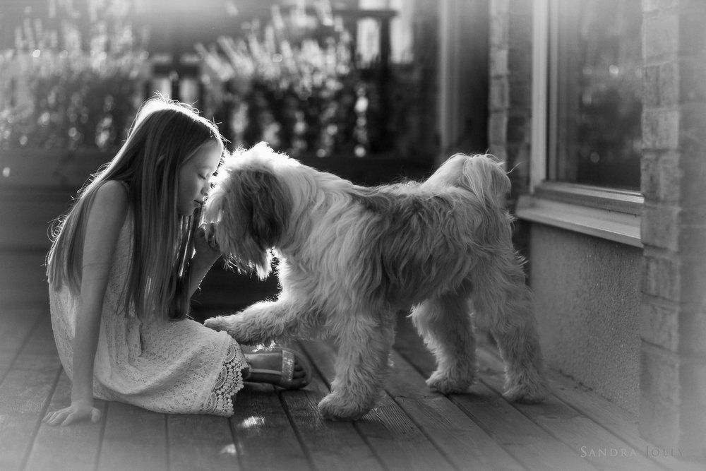 black-and-white-photo-of-girl-and-her-dog-by-barnfotograf-Sandra-Jolly.jpg