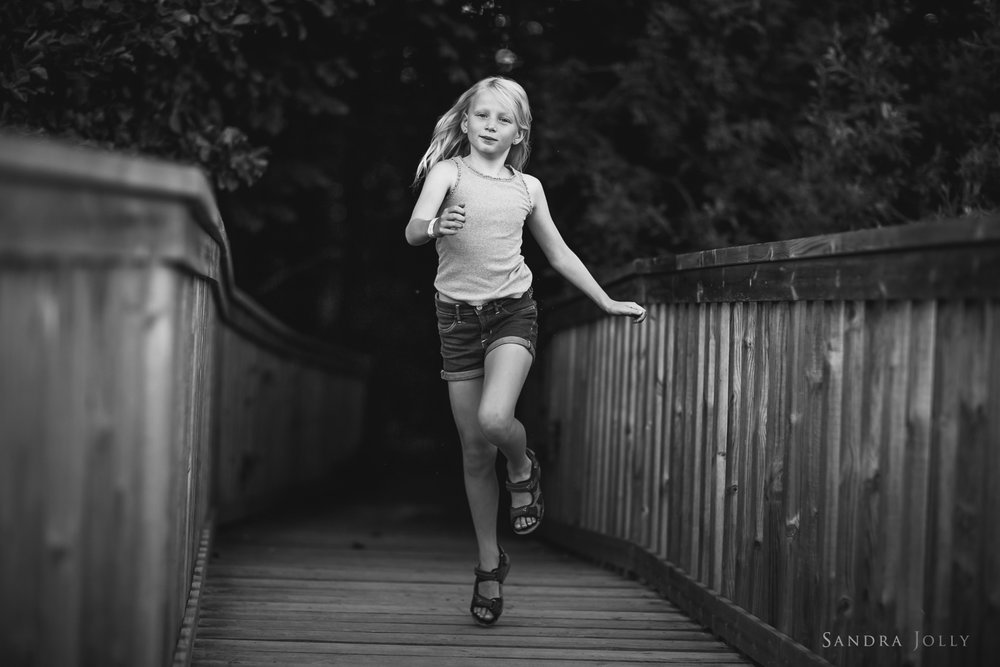 Happy-child-by-Stockholm-child-photographer-Sandra-Jolly.jpg