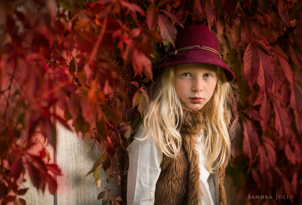 girl-in-red-autumn-leaves-Stockholm-family-photographer-Sandra-Jolly.jpg