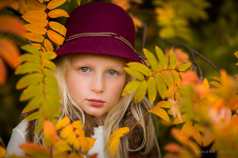 girl-in-autumn-leaves-by-familjefotografering-Sandra-Jolly.jpg