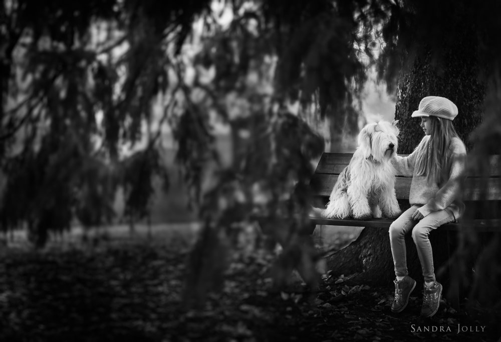 Black-and-white-image-of-girl-and-dog-by-bra-barnfotograf-sandra-jolly.jpg