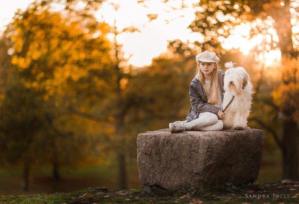 Portrait-of-girl-and-dog--in-sunset-by-bra-familjefotograf-sandra-jolly.jpg