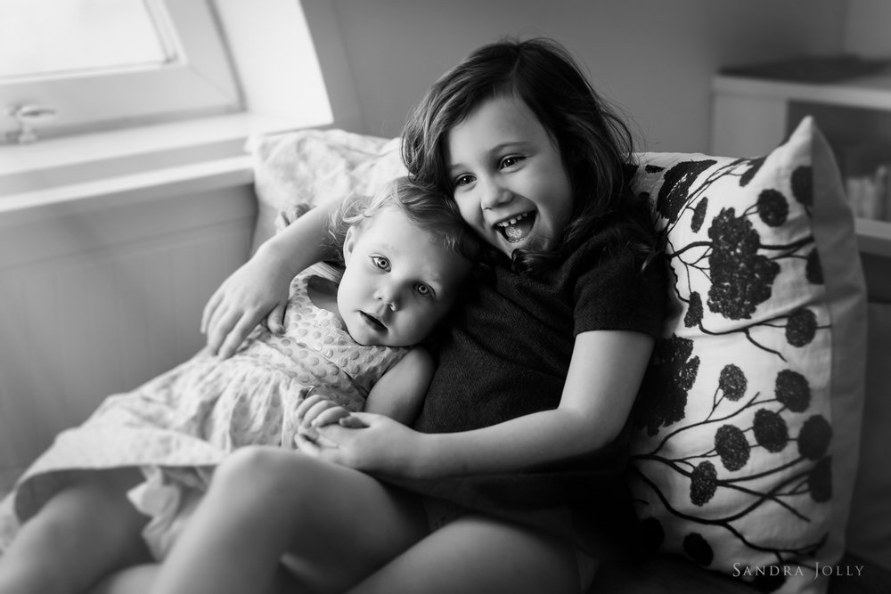 black-and-white-image-of-young-sisters-by-child-photographer-sandra-jolly.jpg