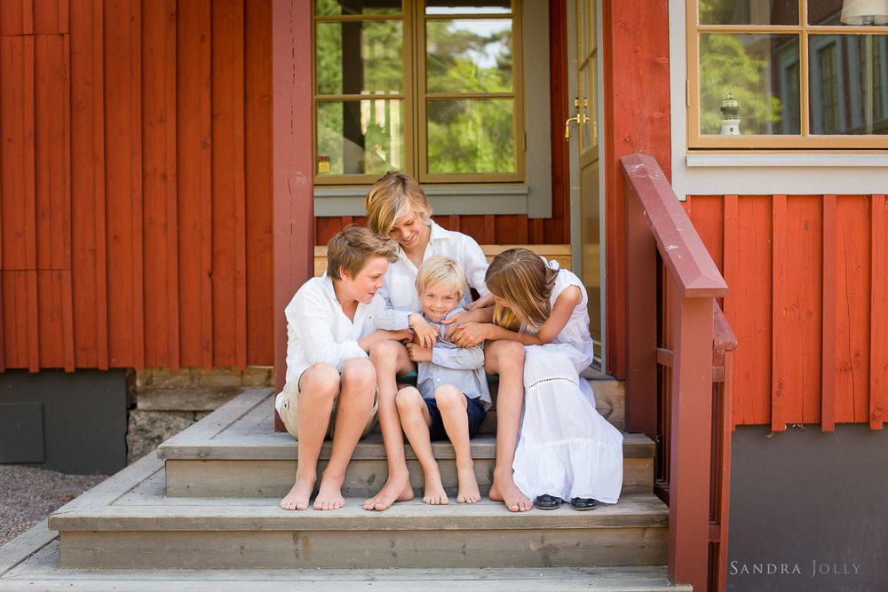 family-at-summer-house-in-Sweden.jpg