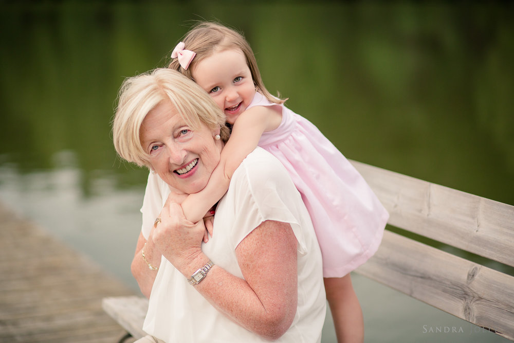 grandma-and-granddaughter-hugging-by-täby-fotograf-sandra-jolly.jpg