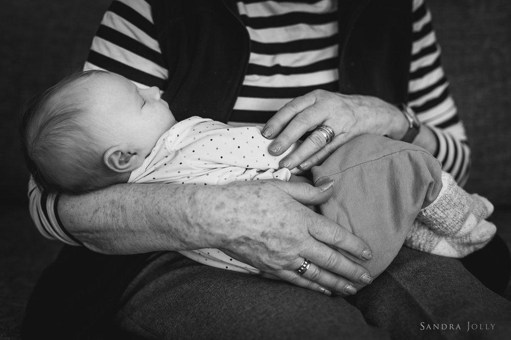 greatgrandmother-holding-greatgrandchild-by-familjefotograf-Sandra-Jolly.jpg