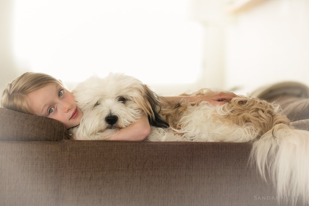 girl-and-her-dog-by-Stockholm-child-photographer-Sandra-Jolly.jpg