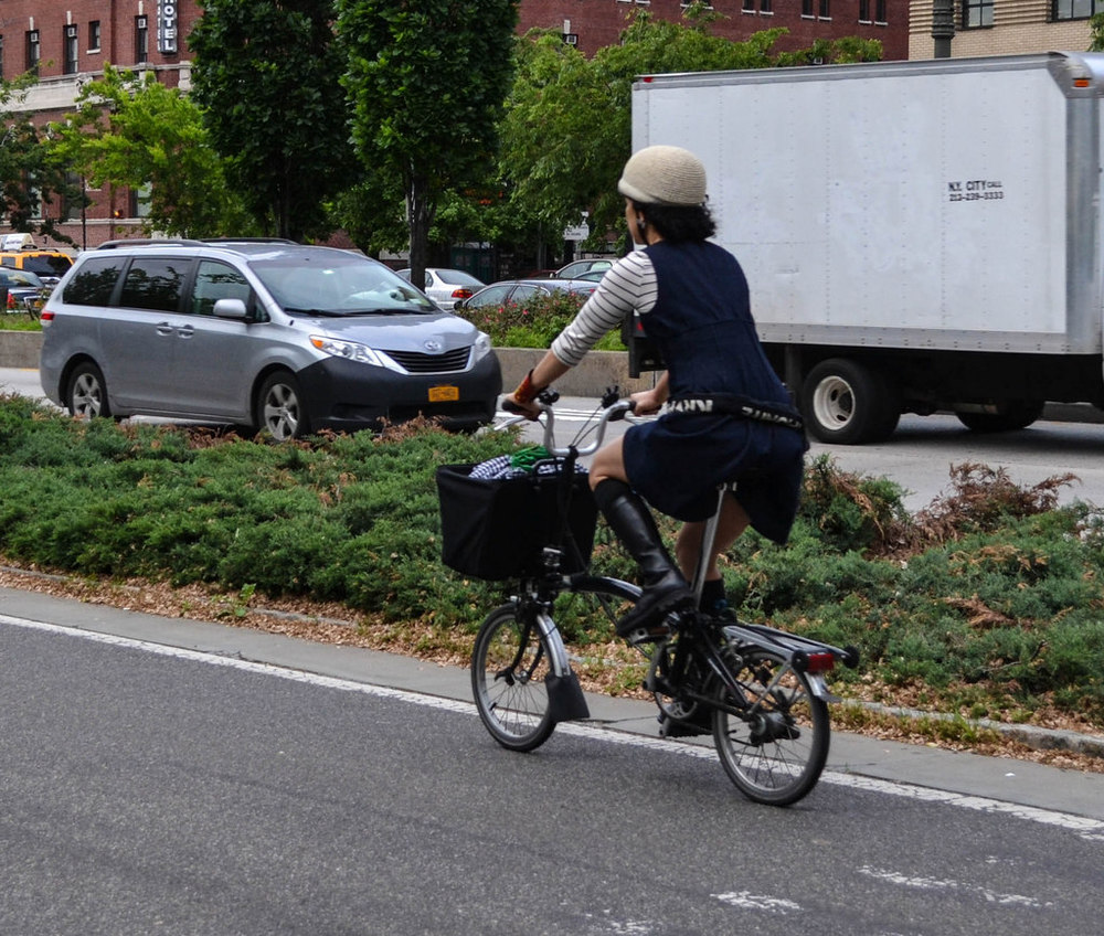 Leather boots, stripes, straw helmet and a folding bike - Hudson River Greenway