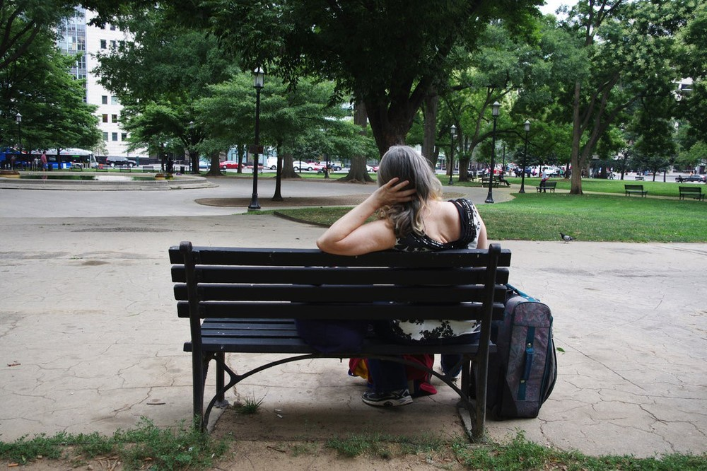 Susan sits on a park bench in Washington, D.C. She has struggled with homelessness for nearly two decades. Gabrielle Emanuel/NPR   #SVdP  #Veterans  #HopefortheHomeless