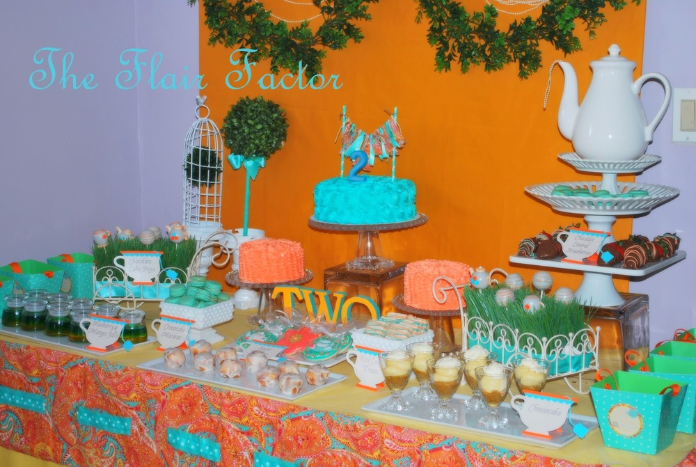 The dessert buffet with its custom linens where a huge hit with the children . . . and the adults. Treats like Jello shooters, macaroons, chocolate covered strawberries, and custom cookies were included.