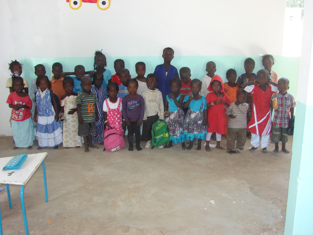 In January we decided to act.  We spent about $1,200 to send  30  of Lambaye's poorest children to pre-school for one year.  We believe in starting early and then following through and by starting these kids in pre-school  right now,  we are giving them the best chance for success.