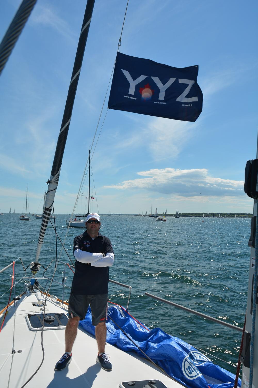 Bowman Derek Joynt standing under YYZ's battle flag at the start of the race