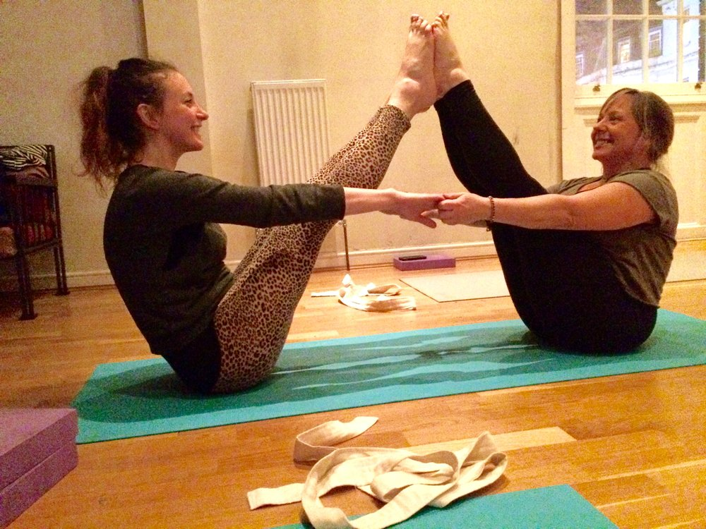 Claire & Karen mastering the Navasana - (Double Boat Pose).