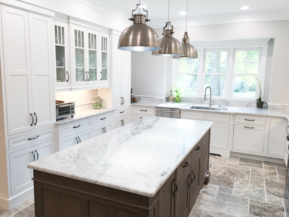 White kitchen with marble counters.jpg