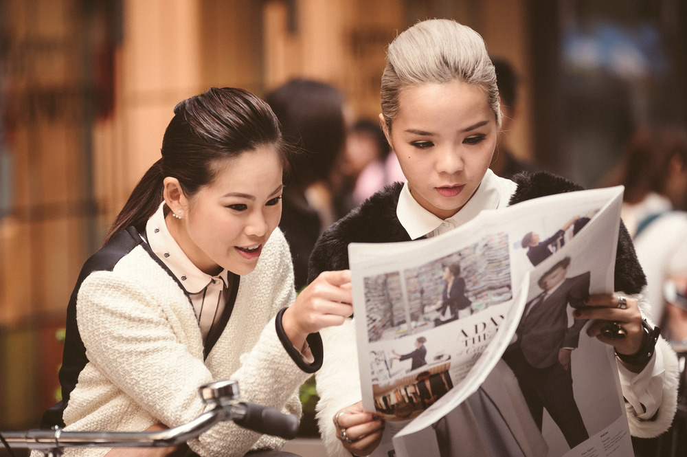 Models for Club Monaco reading a copy of the Journal