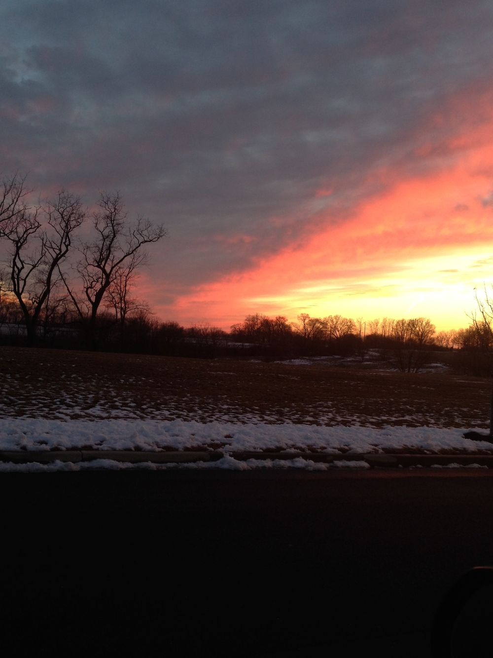 Melting snow and a beautiful sunset in Urbana, Md.