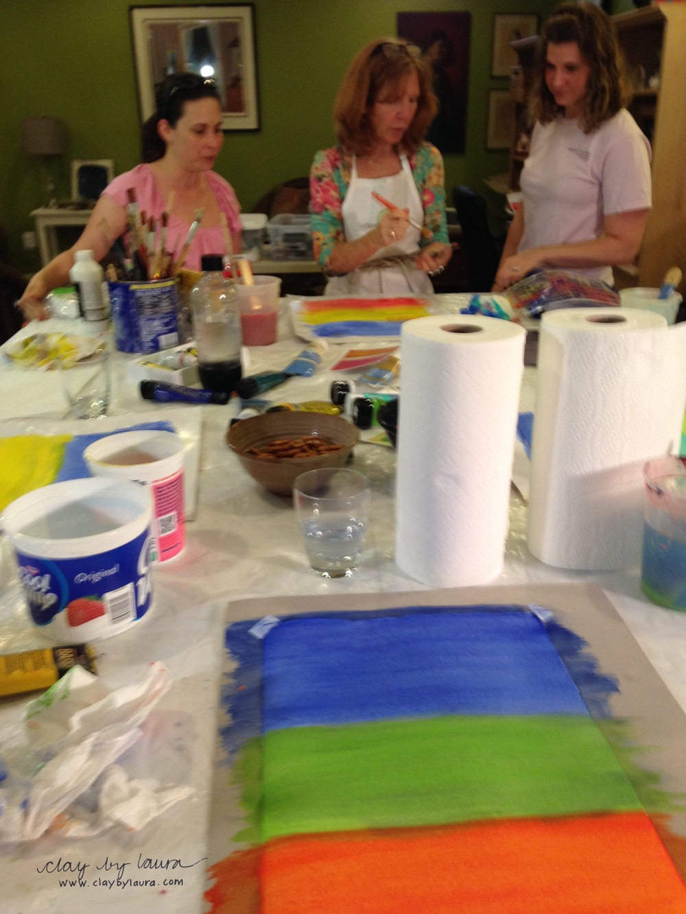 Cathy showed us work by Mark Rothko as inspiration for our first layer of color on the watercolor paper.