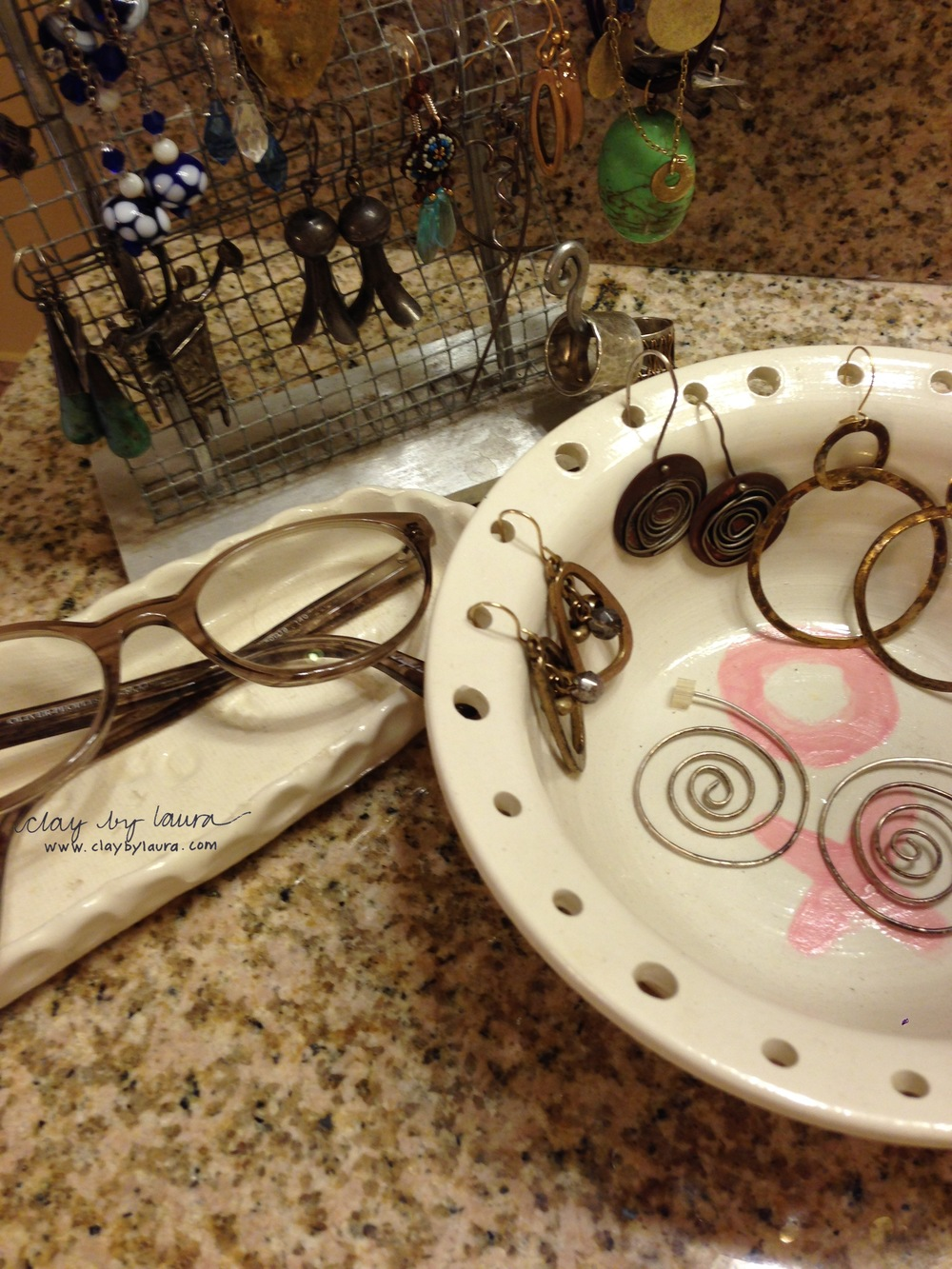 By using a bowl on my bathroom counter, I can easily see my earring collection.