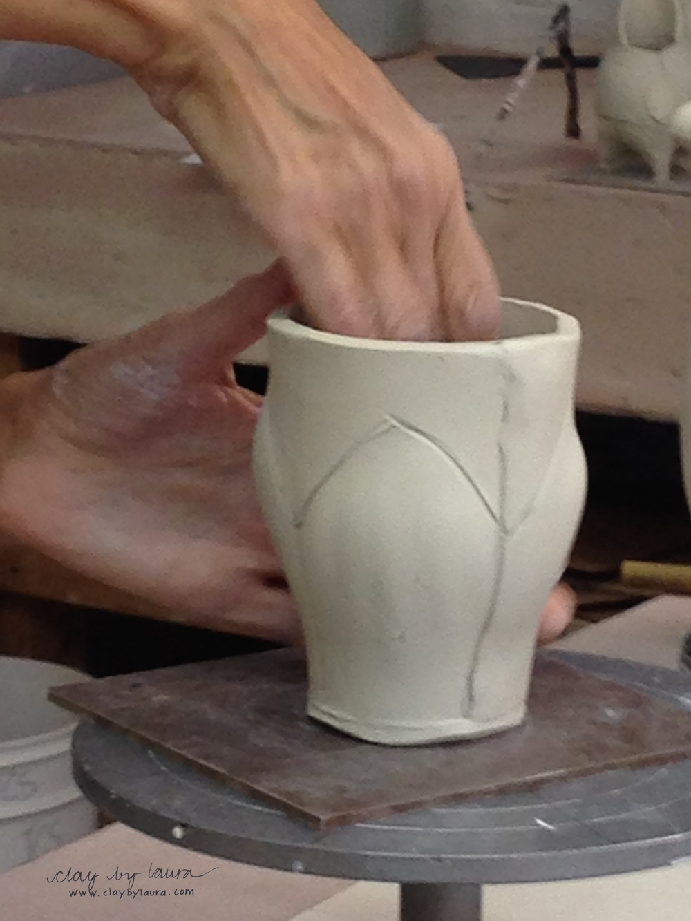 I've watched Sandi's hand-building videos online. It was a pleasure to meet her and see her work the clay in person!