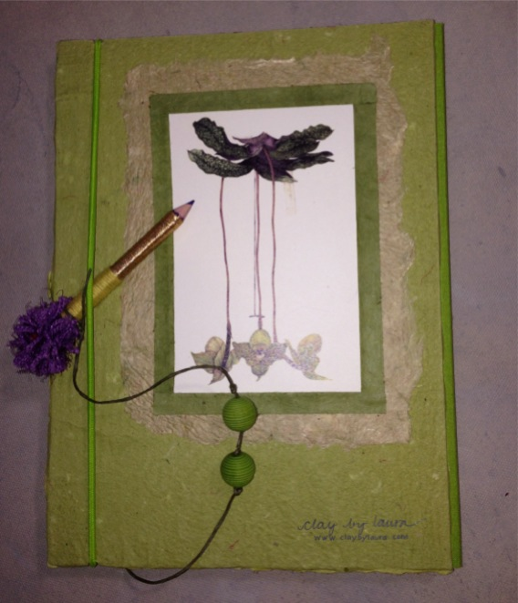 I received this hand-made journal from my artist-friend Pam Kessler. I met Pam when I lived in Hilton Head, SC. She was in town to sell her beautiful botanical watercolor paintings at the Bethesda Row Arts Festival this past weekend. I helped her set up her booth early Saturday morning.