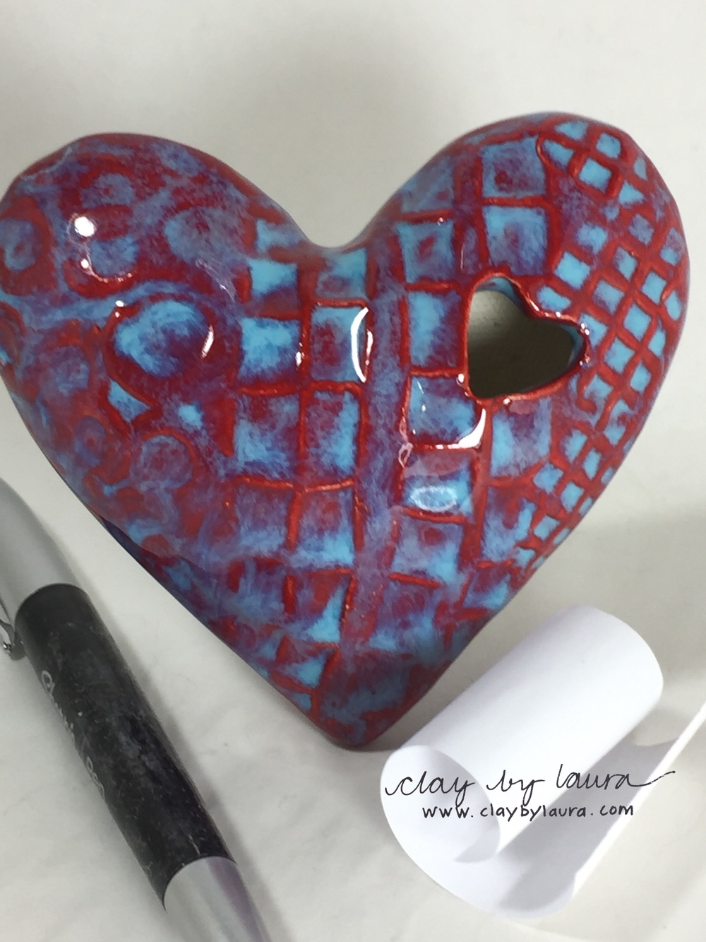 Store 'heartfelt' messages in this heart-shaped clay container. Offered in three color choices, this gift of love can be purchased and shipped for $38.00 (pen is not included).