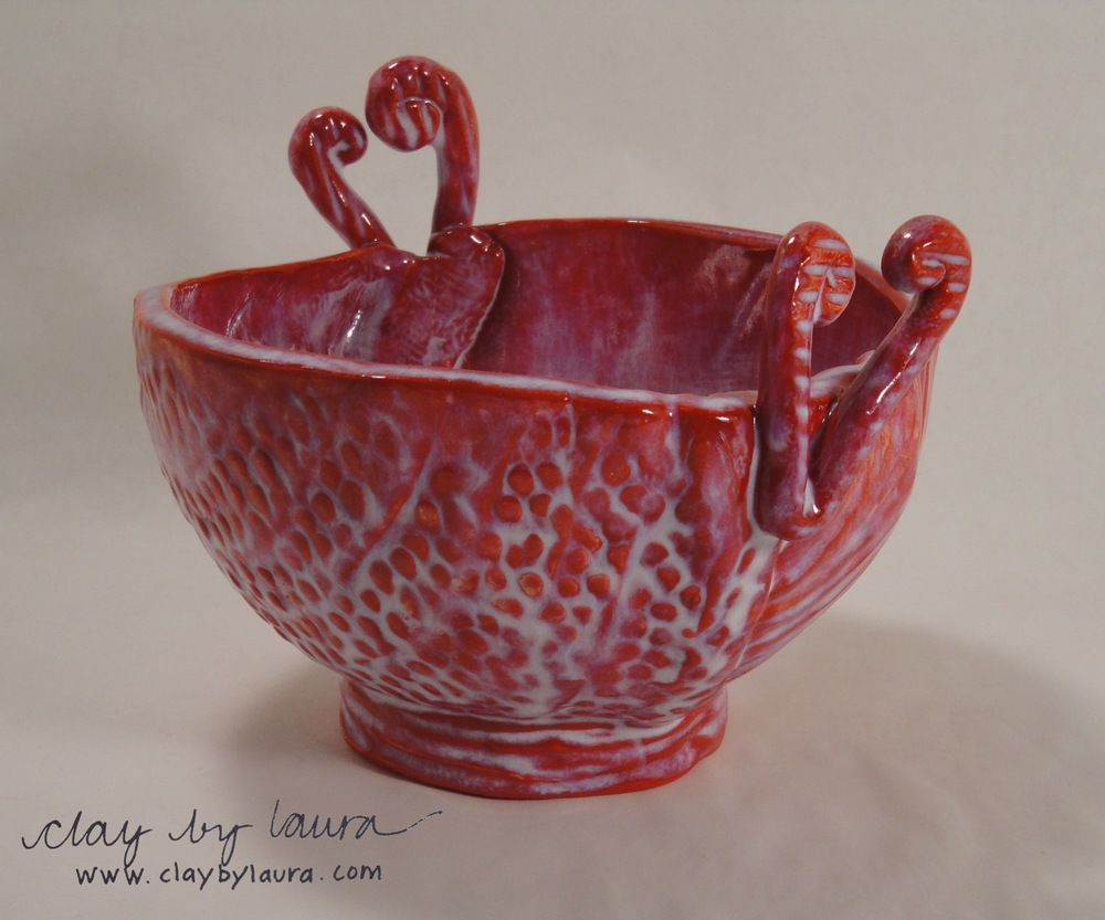 The heart-shaped handle of the Yarn Bowl helps guide the fiber when in use, or simply provides a loving symbol for this multi-functional container. $48 will send one of these to a special someone.