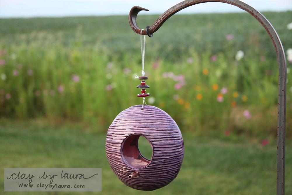 Help the birds flock to your yard with a colorful hanging feeder.